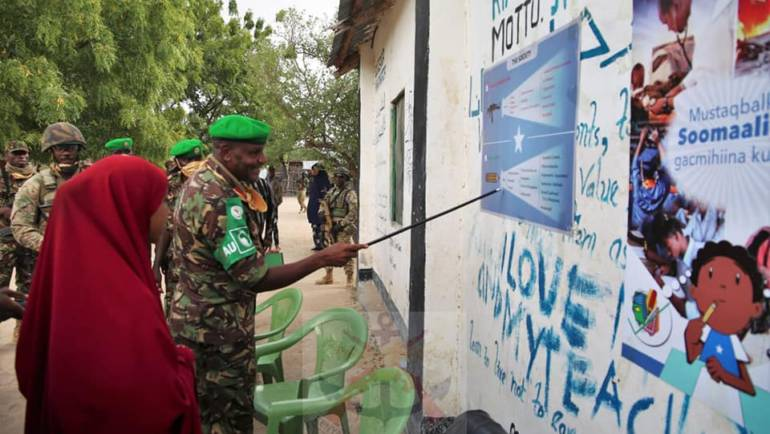 KDF TROOPS IN SOMALIA DONATE DESKS AND FOOD TO LOCALS IN CELEBRATION OF KDF DAY