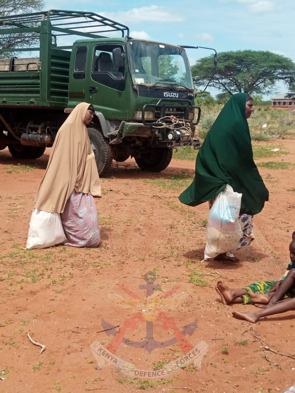 KDF TROOPS SHARE FOOD AND OFFER MEDICAL SUPPORT TO LOCALS AT GHERILLE