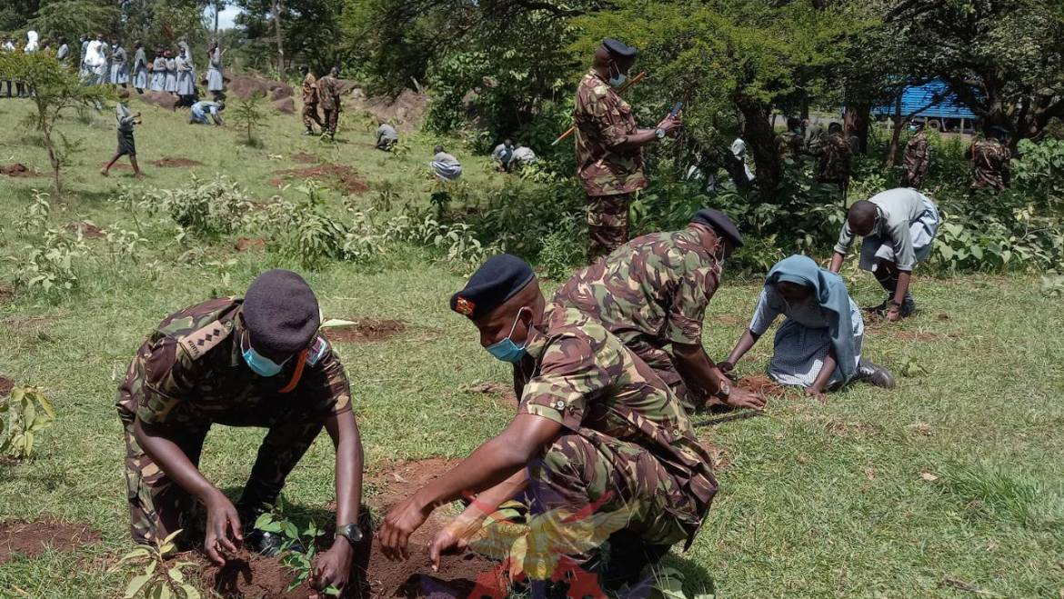 9TH BATALION SOLDIERS TOGETHER WITH MOI BARRACKS SCHOOL PUPILS PLANT TREES TO CONSERVE ENVIRONMENT